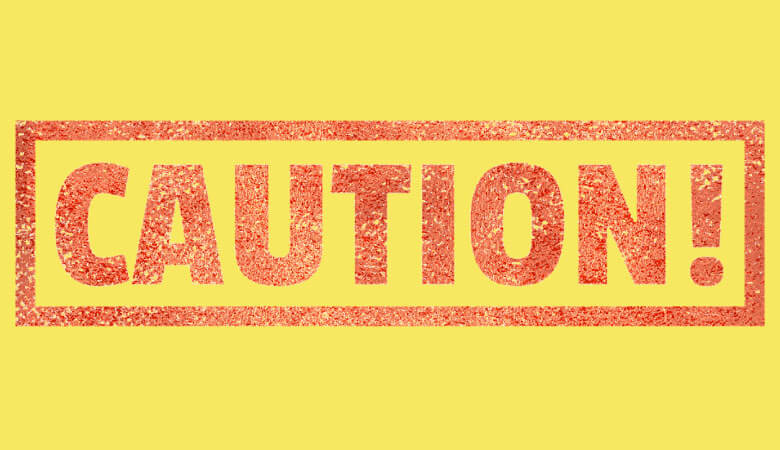 caution stamp on yellow background