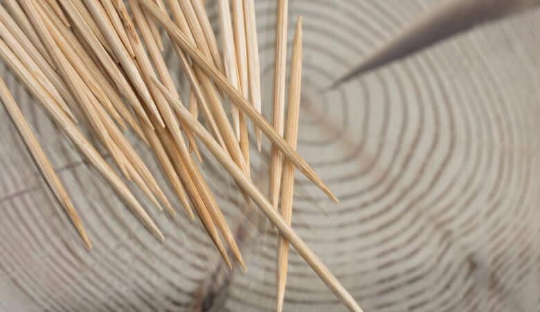 pile of toothpicks on wood