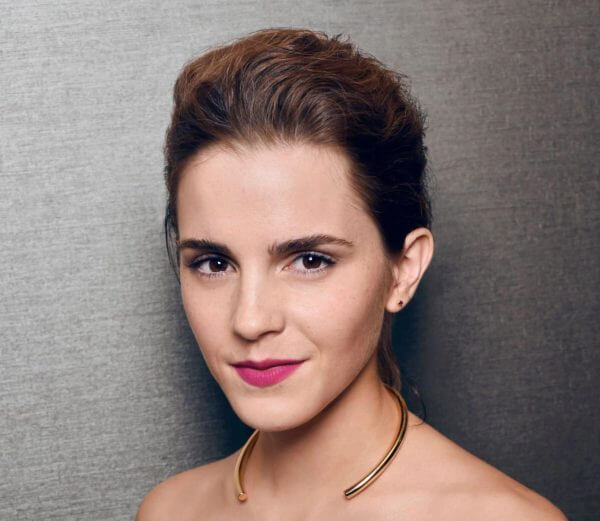 Emma Watson, who played Hermione in the Harry Potter movies, wearing magenta lipstick and her hair in an updo