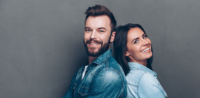 Man and woman with straight smiles