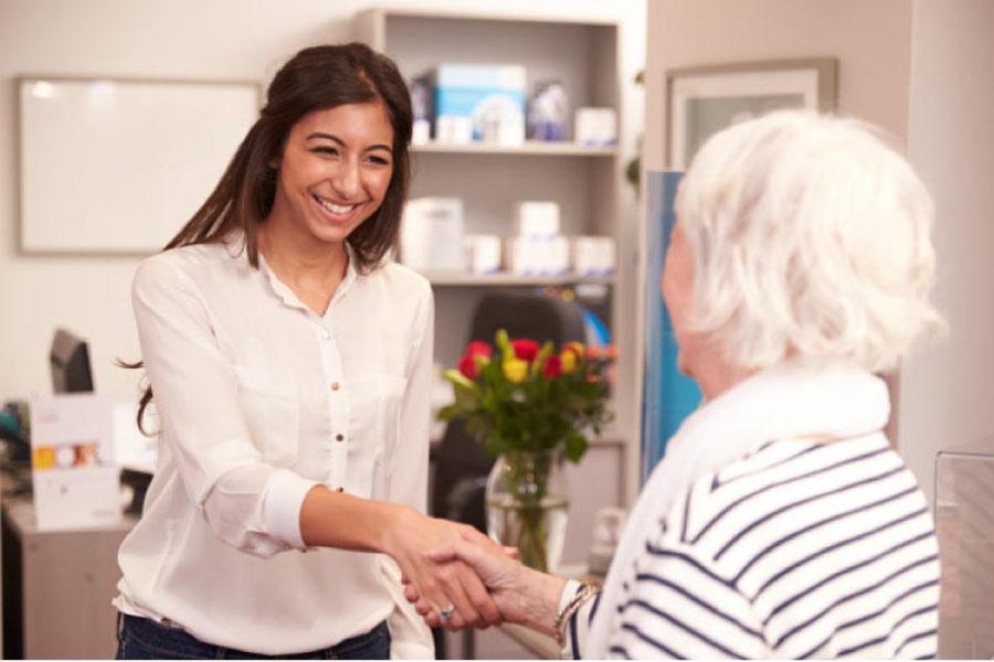 dental assistant welcomes a patient for comprehensive dental care